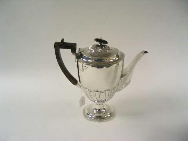 An Edwardian oval pedestal coffee pot, by Charles Stuart Harris, 1909,