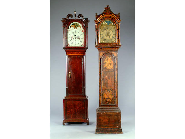 An early 19th century crossbanded oak and mahogany longcase clock