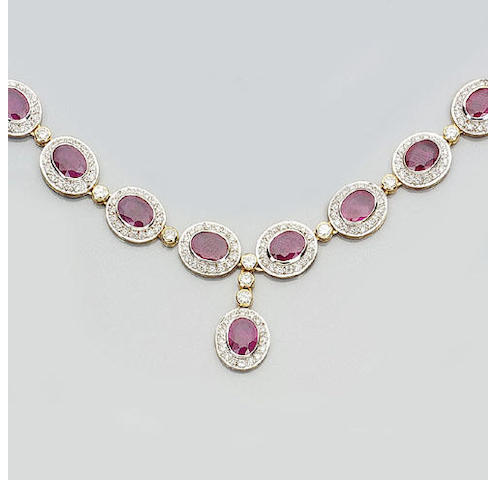 A ruby and diamond cluster necklace