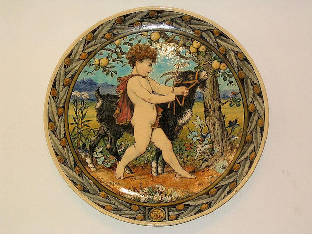 William Stephen Coleman for Minton, 1869 An Earthenware Plaque of a Boy with a Goat