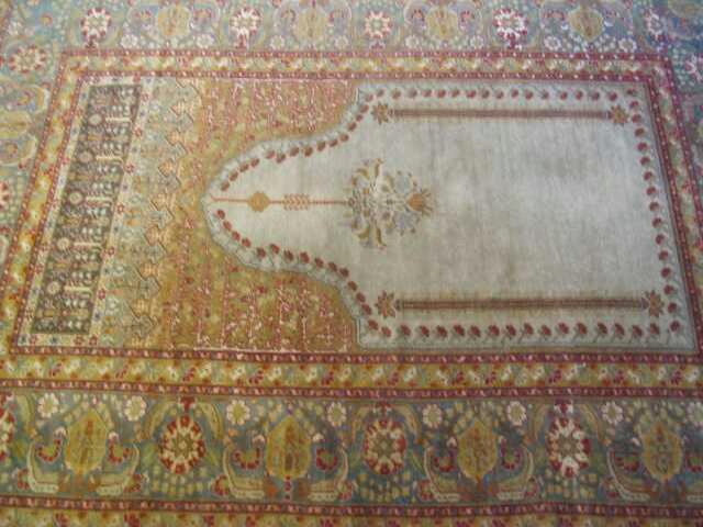 A Ghiordes prayer rug 163 x 119cm