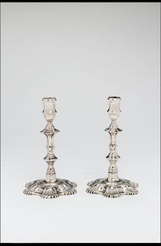 A rare pair of 18th Century Jamaican cast candlesticks by Gerardus Stoutenburgh, Assay Master's mark of Anthony Danvers, Jamaica, circa 1765, (maker's mark struck twice, Assay Master's mark once and an alligator's head),