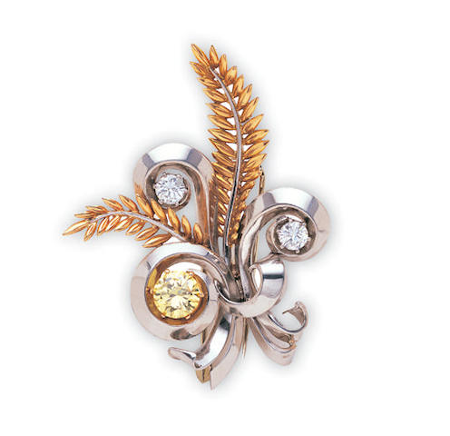 A yellow diamond and diamond brooch by Boucheron