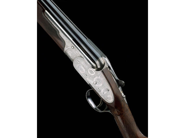 A FINE 12-BORE SINGLE-TRIGGER OVER-AND-UNDER SIDELOCK EJECTOR GUN BY BOSS, NO. 6848 In a leather case