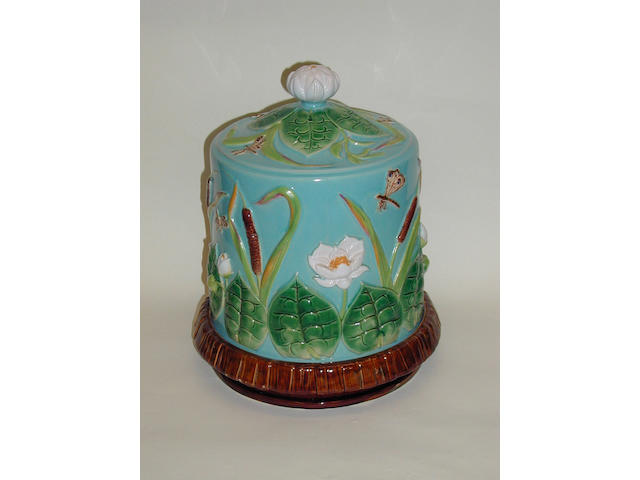A George Jones majolica cheese bell and stand,