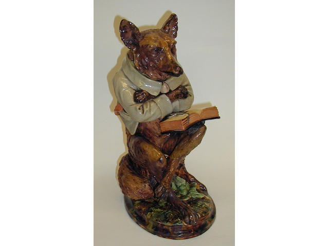 A Whittman & Roth majolica figure of a wolf,