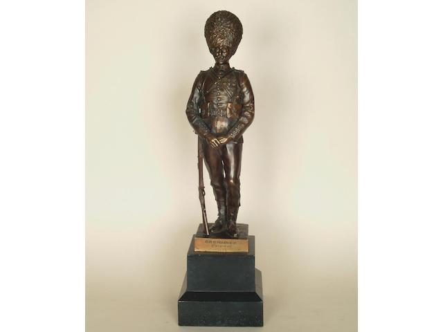 G.E.Wade: A bronze figure of a Grenadier Guard