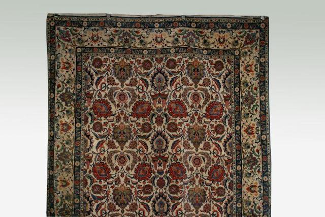 A Tabriz ivory ground carpet,