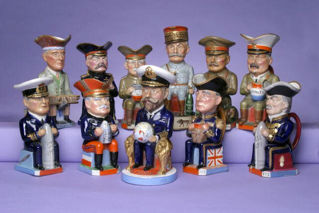 A set of eleven Williamson pottery character jugs,