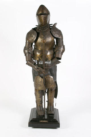 A 19th Century model of a Maximillion Period (1500 - 1525) suit of armour and various swords.