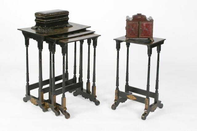 A quartetto nest of Victorian black lacquered and painted tables,