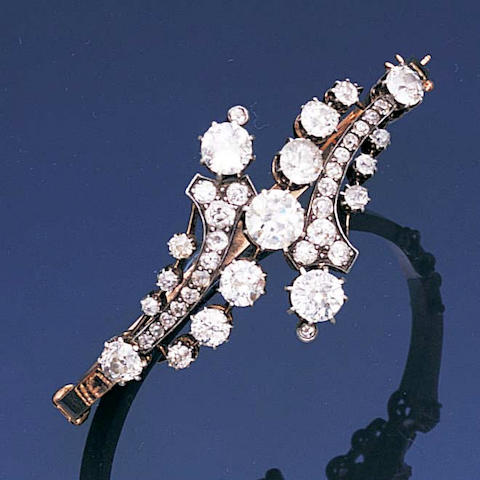 A late 19th century diamond hinged bangle