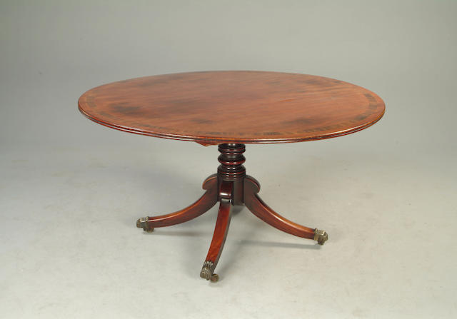 A George III style mahogany and rosewood banded breakfast table