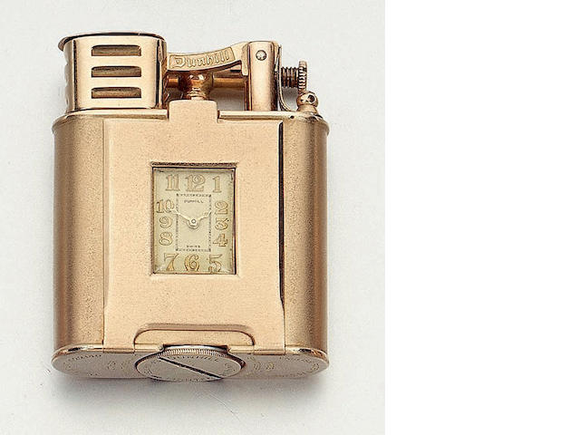 Dunhill. A rare 9ct gold watch lighter London Import mark for 1929, No.753