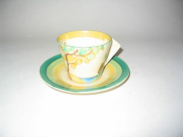 'Secrets' A Conical Cup and Saucer