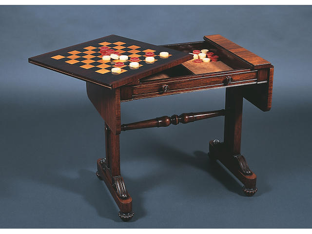 A George IV rosewood sofa type games table,