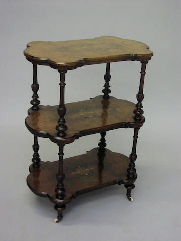A Victorian burr walnut and inlaid three tier whatnot,