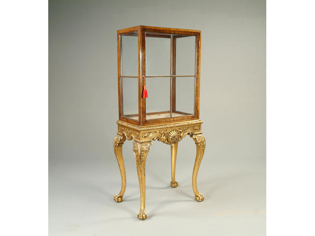 An early 20th century burr walnut and gilt wood display cabinet on stand