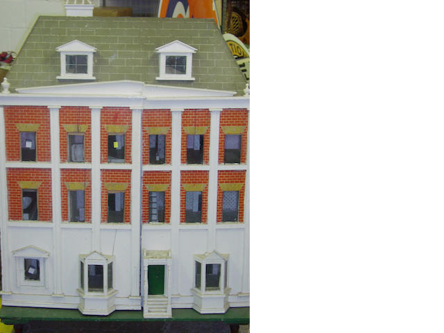 A large painted wooden dolls house probably Lines Brothers, English circa 1910