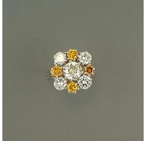 A diamond and fancy deep orangey/yellow diamond cluster ring