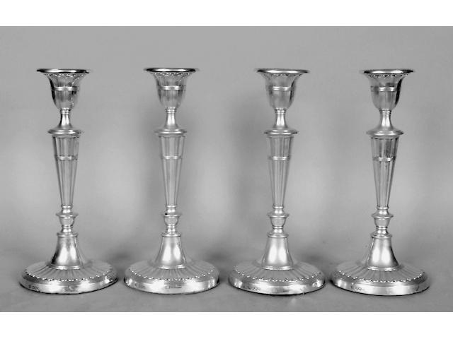 A set of four neo-classical style candelsticks, John Round & Son Ltd, Sheffield 1919,