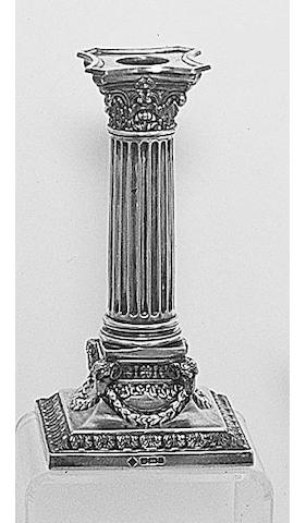 A pair of late Victorian dwarf Corinthian column candlesticks, by Martin and Hall, Sheffield, 1894,