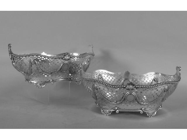A good matched pair of large pierced baskets, Charles Stuart Harris, 1898 & 1900,