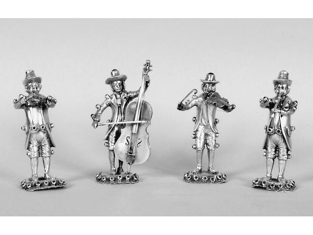 A set of four Continental silver figures of musicians