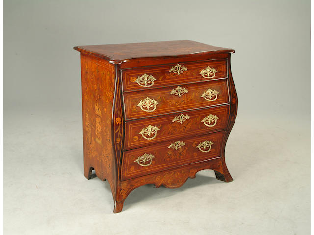 A 18th century Dutch mahogany and floral marquetry bombe commode