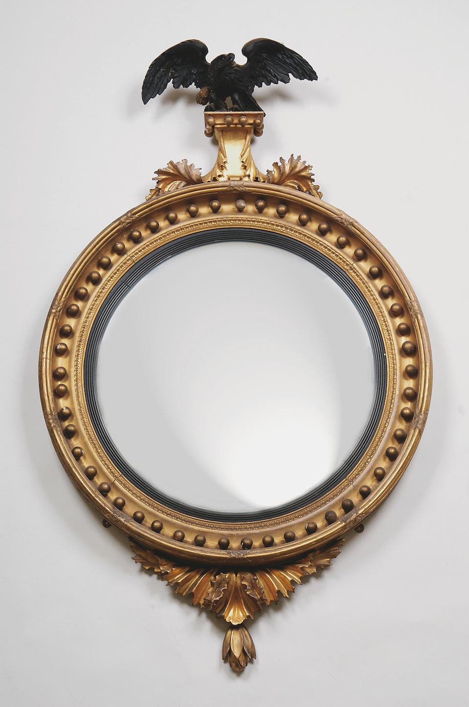 A Regency carved and gilt gesso wall mirror,