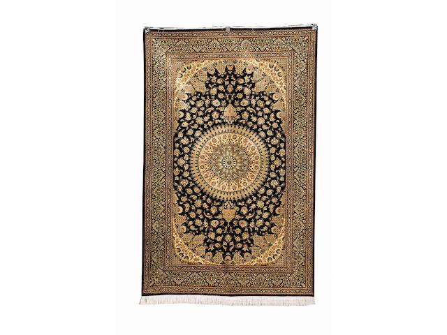 A very fine 'Razavi' Qum silk rug Central Persia, 204cm x 130cm