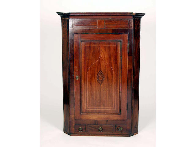 A 19th Century mahogany and inlaid hanging corner cupboard,
