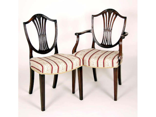 A set of eight 19th Century mahogany shield back dining chairs including two carvers,