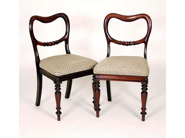 A set of five William IV mahogany balloon back dining chairs,