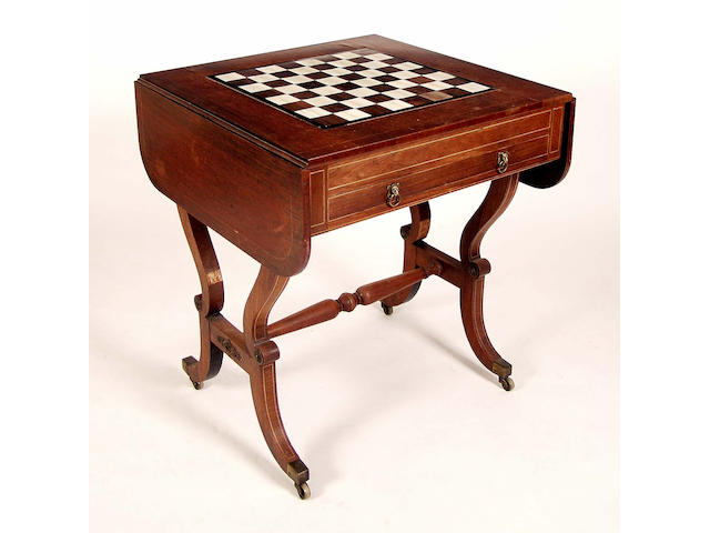 A Regency mahogany and boxwood strung Pembroke games table,