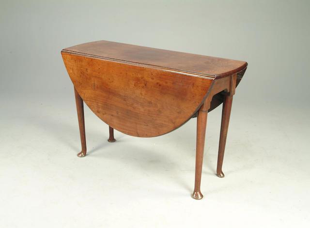 A mid 18th Century mahogany drop-flap dining table