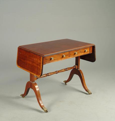 A Regency style mahogany and satinwood banded sofa table