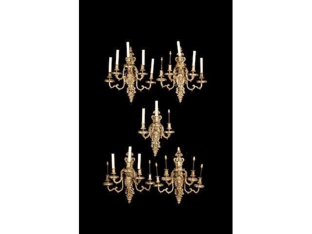 A set of four gilt metal Louis XIV style five branch wall lights
