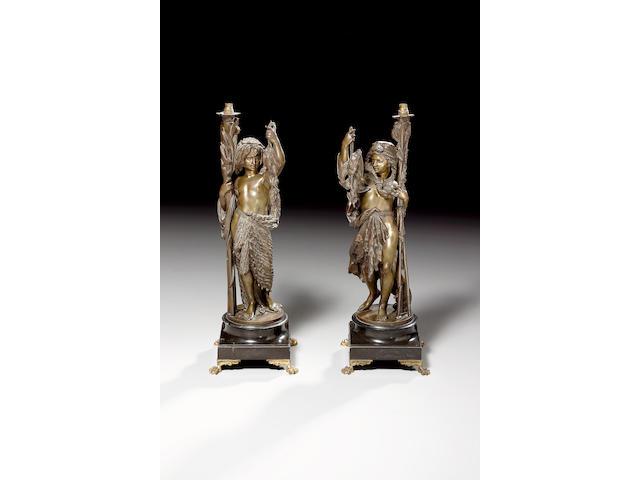 After Carrier- Belleuse, Alfred Ernest (1824 - 1887): a pair of bronze figural lights