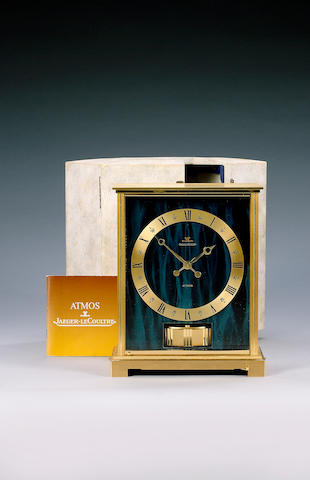 Jaeger-Le-Coultre. A 20th century lacquered brass and green enamel mantel timepiece Atmos