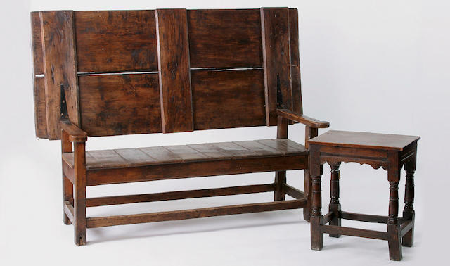 A late 18th Century sycamore and ash table settle,