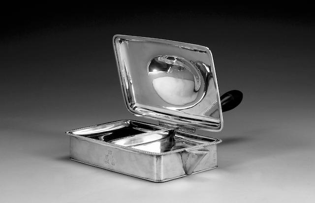 A George III silver cheese warming dish, by Parker & Wakelin, circa 1770, date letter rubbed, with an unmarked detachable cover probably of a later date,