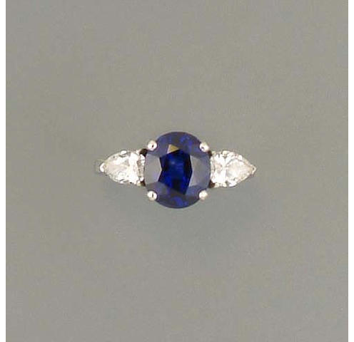 A diamond and sapphire three-stone ring