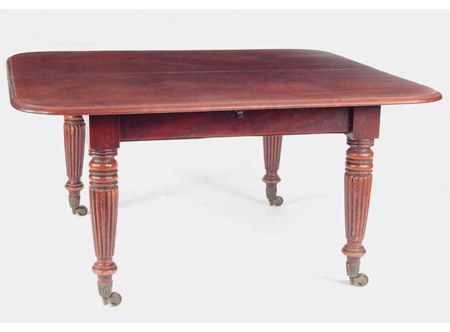 A William IV mahgoany dining table the top with rounded corners and a moulded edge, on tapered reeded legs with foliate brass cappings and castors, together with three leaves 360 x 143cm extended.
