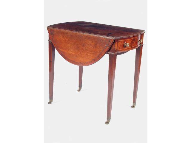 A George III mahogany oval pembroke table