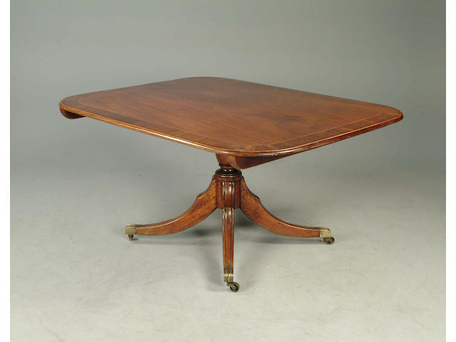 A late George III mahogany and crossbanded breakfast table