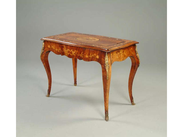 A Louis XV style walnut, marquetry inlaid and gilt metal mounted centre table