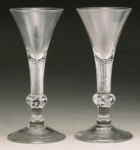 A good pair of composite stem wine glasses circa 1740