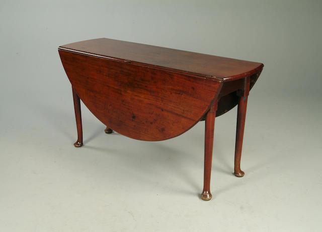 A mid 18th Century mahogany oval dropleaf gateleg table