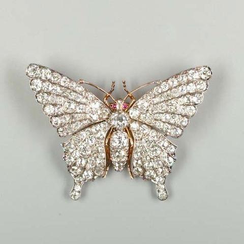 A diamond-set butterfly brooch,
